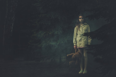 Lost Emotionless Girl with Teddy Bear in the Middle of Dark Night Forest