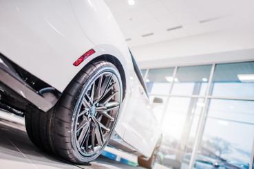 Luxury Sports Vehicle Inside Dealership Showroom