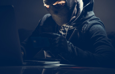 Masked Hacker and Stolen Credit Card Online Purchases