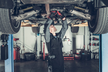 Mechanic Fixing Car on a Lift