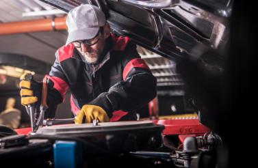 Mechanic Restoring Car