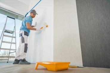 Men Applying Vinyl Wallpaper in a Room