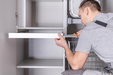 Men Assembling Cabinets