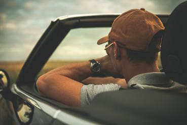 Men Behind Convertible Car Steering Wheel