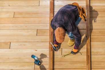 Men Building Wooden Deck