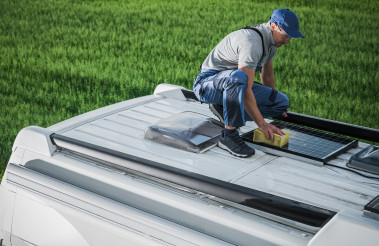 Men Cleaning Camper Van RV Roof Installed Solar Panels