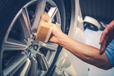 Men Cleaning Car Alloy Wheel