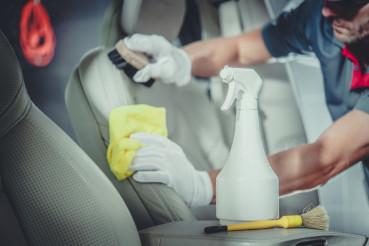Men Cleaning Car Interior
