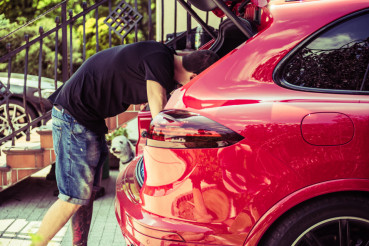 Men Cleaning Car Trunk