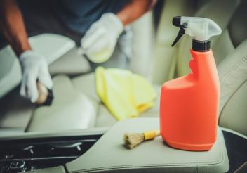 Men Cleaning Vehicle Interior Using Sanitizing Detergent