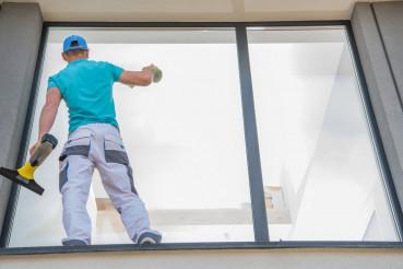 Men Cleaning Window Outside