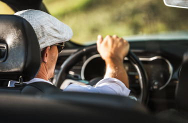 Men Driving Convertible Car