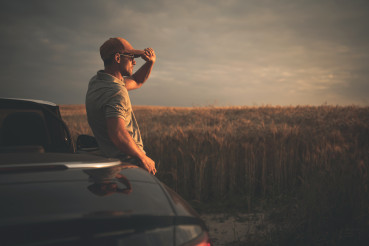 Men Enjoying Countryside Sunset While on Drive For Pleasure