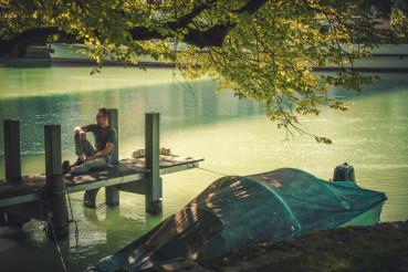 Men Enjoying Summer Time on the River Pier