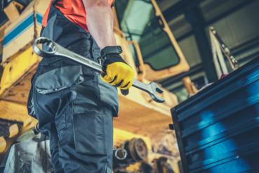 Men Fixing Heavy Machinery