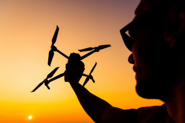 Men Flying Small Drone