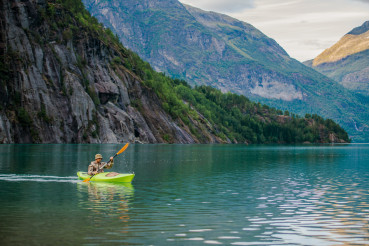 Men in a Kayak on Glacial Lake in the Norway