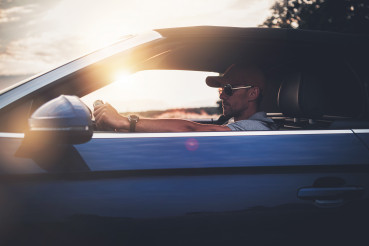 Men in His 40s Enjoying Drive in His Convertible Car