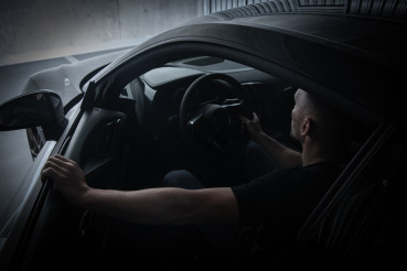 Men Parking Black Exotic Car Inside Underground Garage