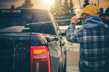 Men Power Washing His Pickup Truck