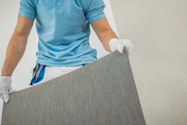 Men Preparing New Vinyl Wallpaper for Wallcover