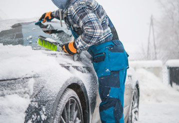 Men Removing Fresh Fallen Snow From His Car