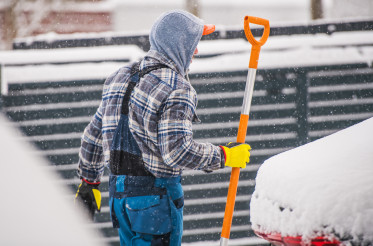 Men Removing Snow During Heavy Snow Fall