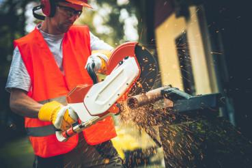 Men Using Metal Cutter