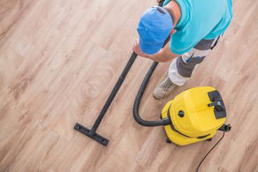 Men Vacuuming Apartment