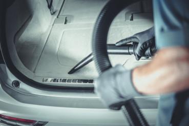 Men Vacuuming His Car