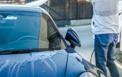 Men Washing His Blue Sporty Looking Car