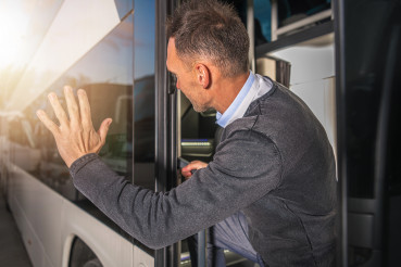 Men Waving to Someone Leaving in a Bus Goodbye Gesture