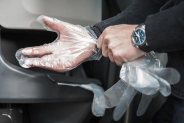 Men Wearing Disposable Transparent Vinyl Gloves