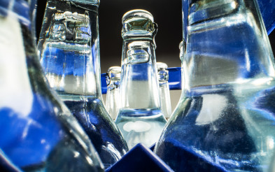 Bottles Of Mineral Water In Plastic Case.