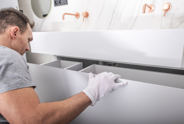 Modern Bathroom Cabinets Installation by Caucasian Worker