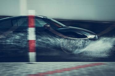 Modern Performance Car Speeding Through the Water
