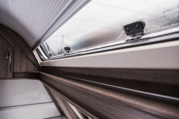 Modern RV Camper Van Rounded Window and Shades Close Up