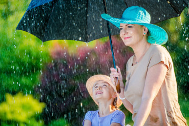Mother with Daughter in Rain