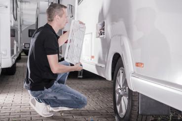 Motorhomes RV Technician Repair Travel Trailer Refrigerator From Outside