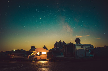 Mountain RV Park Motorhome Camping Under Starry Sky