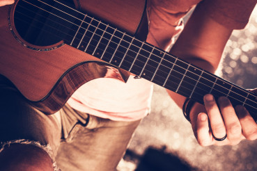 Musician with Acoustic Guitar