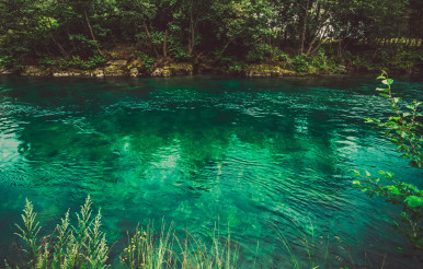 Crystal Clear Waters Of River In Norway.