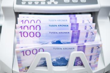 Norwegian Kroner Banknotes Inside Bill Counter