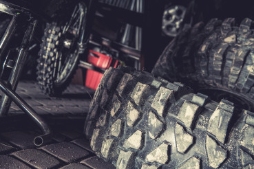 Off Road Vehicle Tires Laying in a Garage
