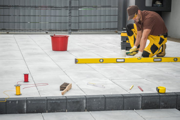 Outdoor Patio Tiles Installation by Professional Worker