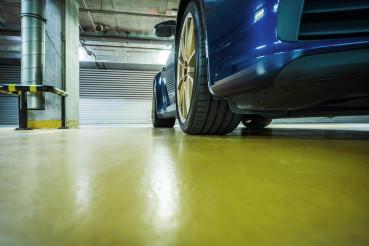 Sports Car In Underground Parking Lot Garage.