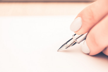 Pen Writing on the Paper