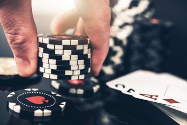 Poker Player Placing Bid