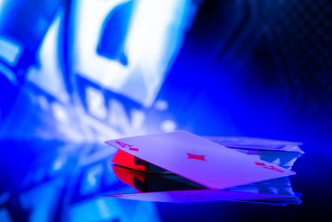 Poker Playing Cards on a Glassy Table