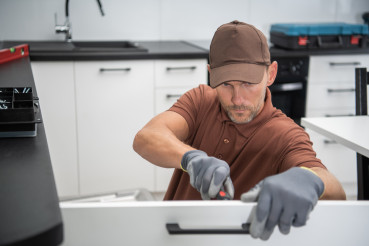 Pro Cabinetmaker Installing New Kitchen Furnitures